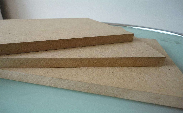 What are the characteristics of building fiberboard and particle board?